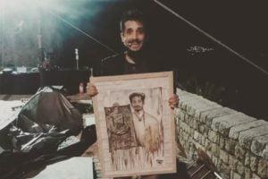 L'omaggio di una fan al comico Roberto Lipari: foto-dipinto del suo volto sparse per la città di Palermo